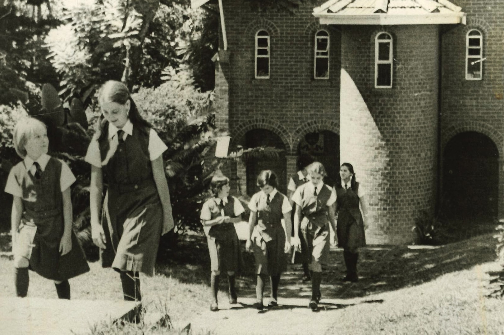 Children walking through a school.